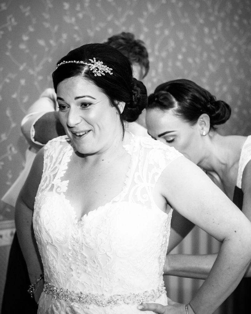 Bride getting in dress, Wortley Hall wedding, Sheffield wedding photographers