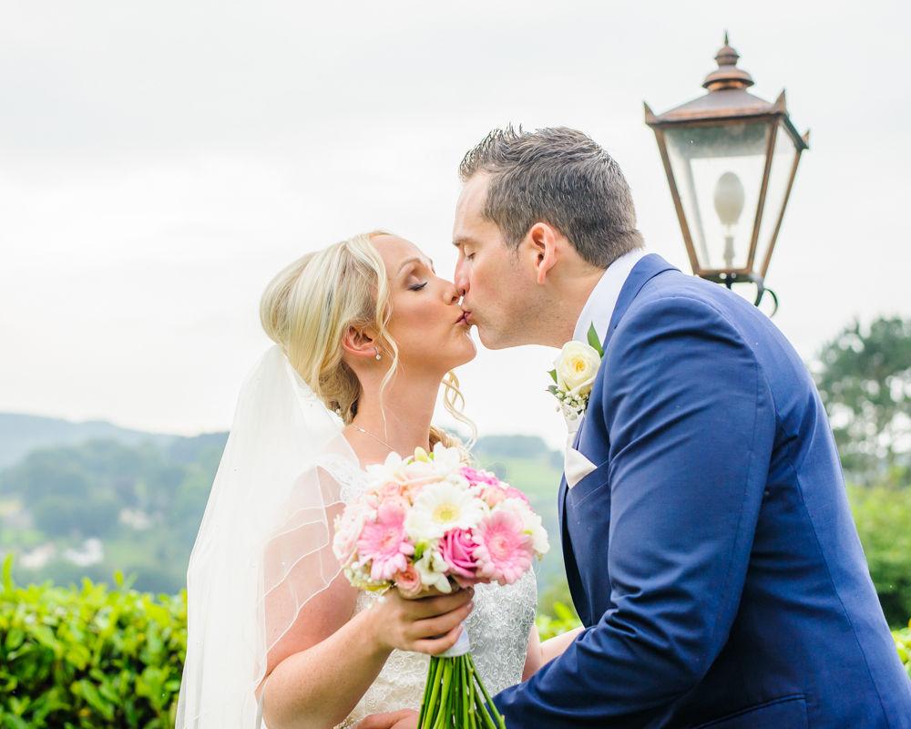 Kisses in grounds of Maynard, Maynard wedding photography Sheffield