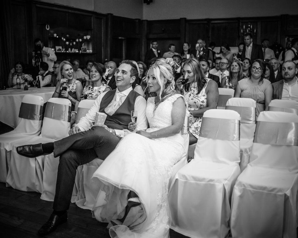 Watching a film on wedding day, Maynard wedding photography Sheffield