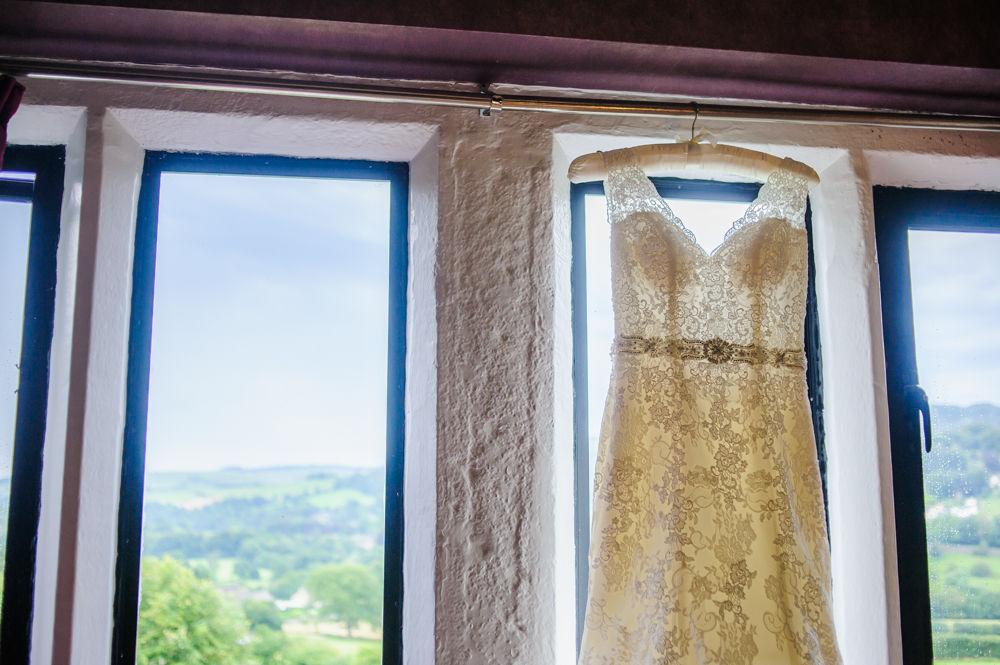 Wedding dress hanging up, Maynard wedding photography Sheffield