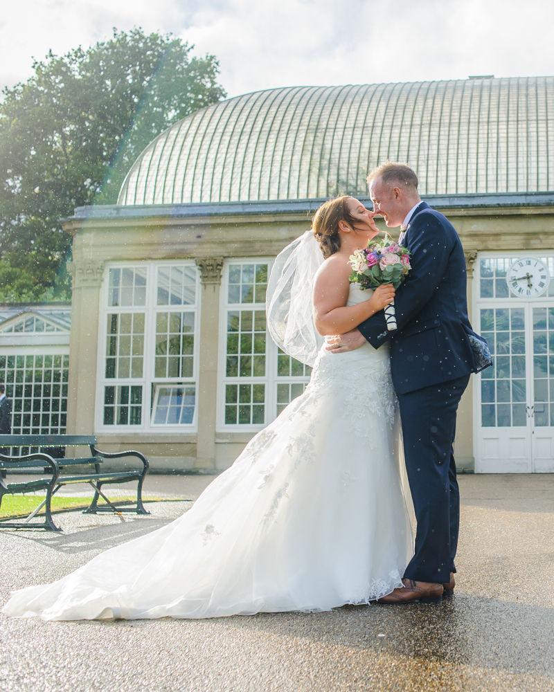 Kissing in rain,  Botanical Gardens Wedding Sheffield