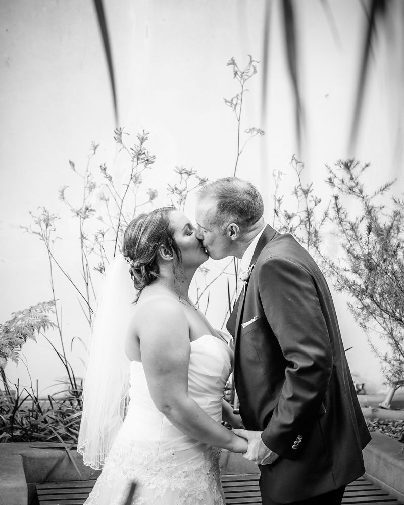 Kisses inside greenhouse,  Botanical Gardens Wedding Sheffield