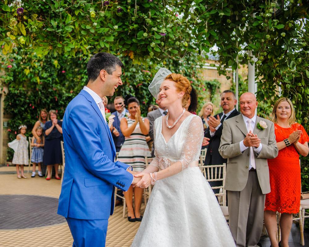 Laughing in ceremony, Cumbria wedding photographers