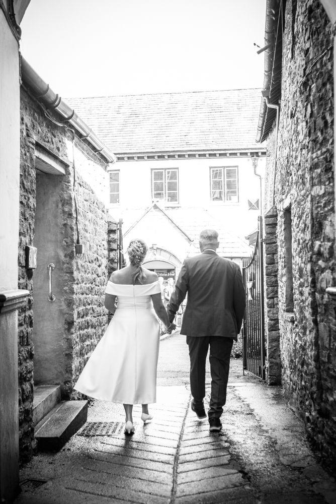 Walking into wedding, Cumbria wedding photographers