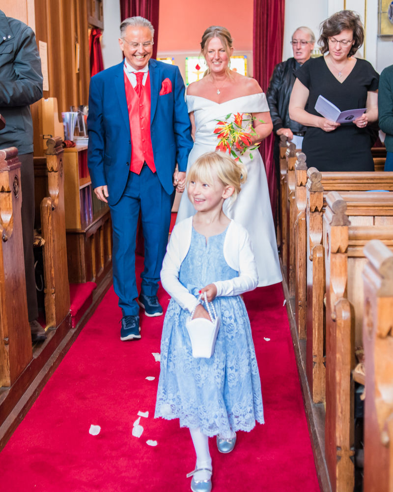 Flowergirl sprinkling petals, Cumbria wedding, Kendal