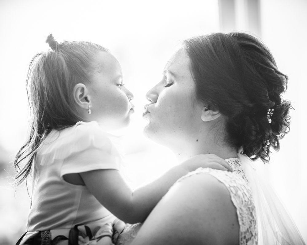 Flower girl kisses for bride, Gretna Green wedding photographers