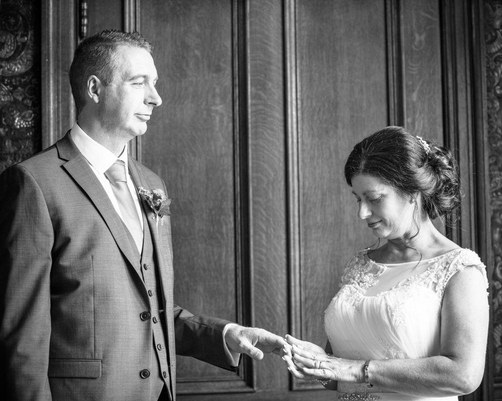 Gill putting ring on Monty, Lingholm wedding, Lake District