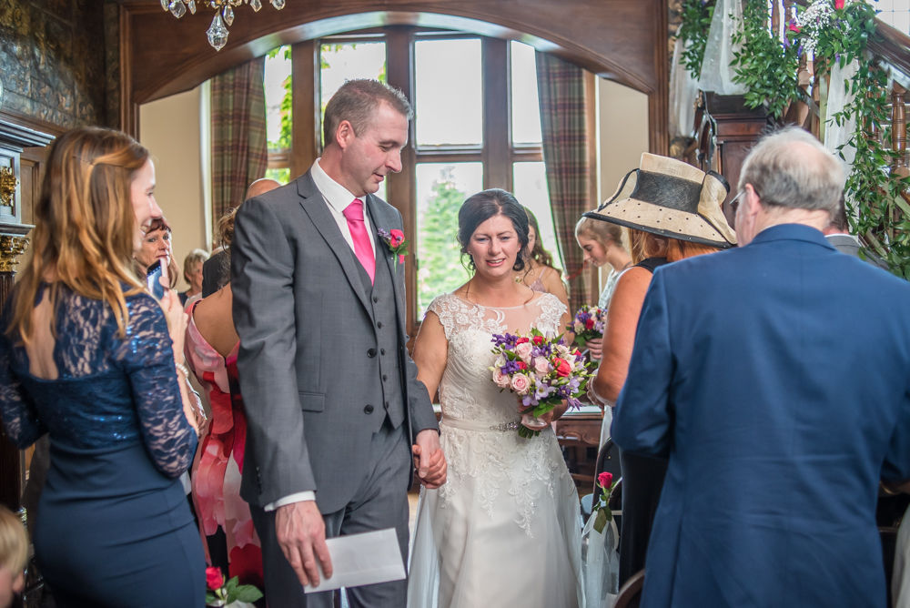 Walking down aisle, Lingholm wedding, Lake District