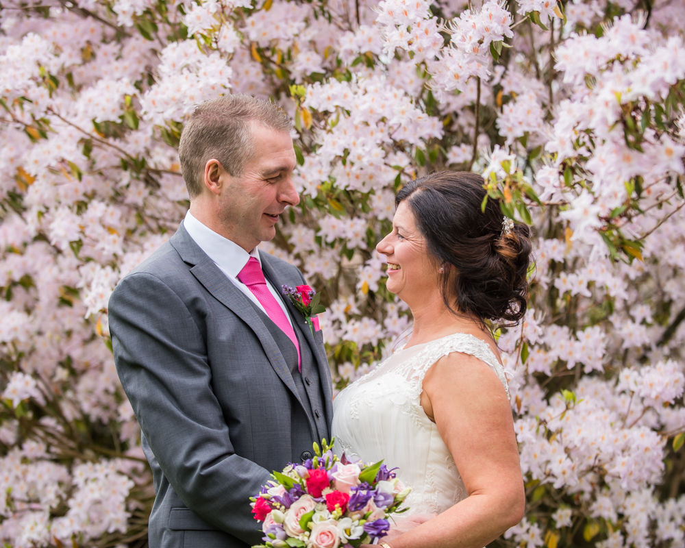 Smiles in the blossom, Lingholm wedding, Lake District