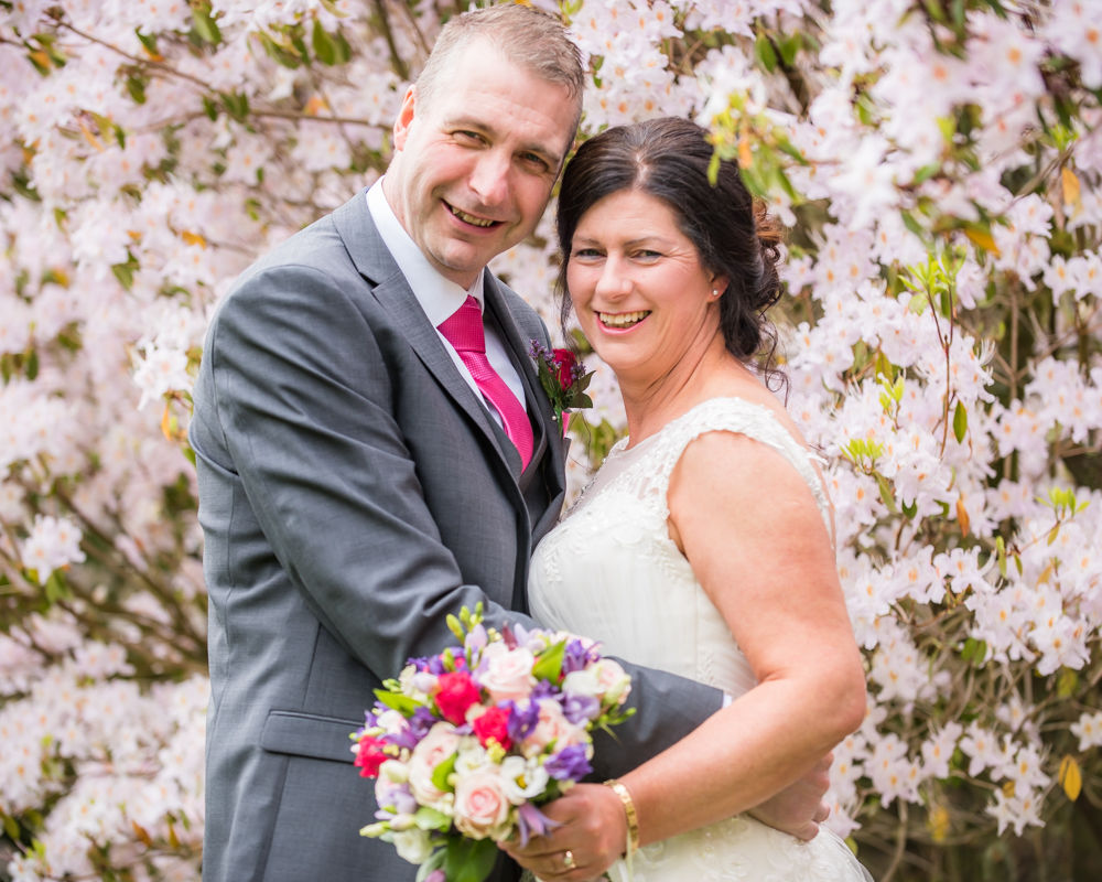 Laughing for camera, Lingholm wedding, Lake District