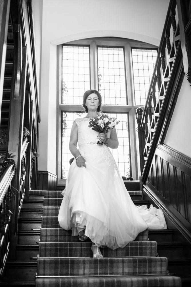 Gill walking downstairs to wedding, Lingholm wedding, Lake District