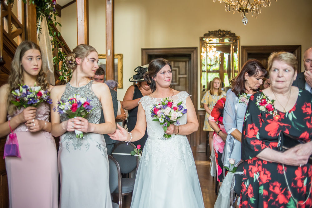 getting support from her daughter walking down aisle, Lingholm wedding, Lake District