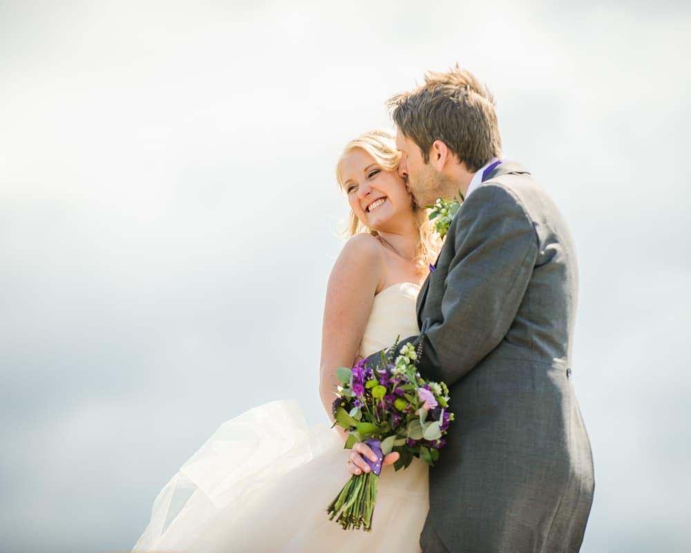 Kisses on Peak District rocks, Maynard wedding, Sheffield photographers