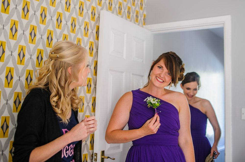 Checking out the buttonholes, Maynard wedding, Sheffield photographers