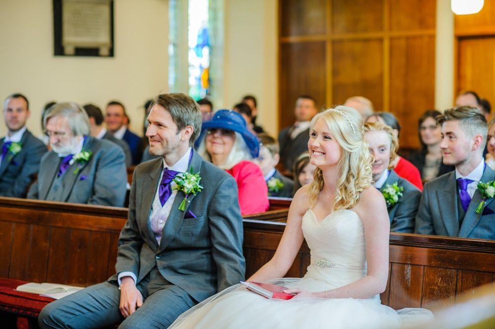 Holding hands during ceremony, Maynard wedding, Sheffield photographers