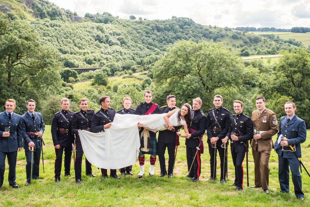 Bride carried on groomsmen portrait, Peak District weddings