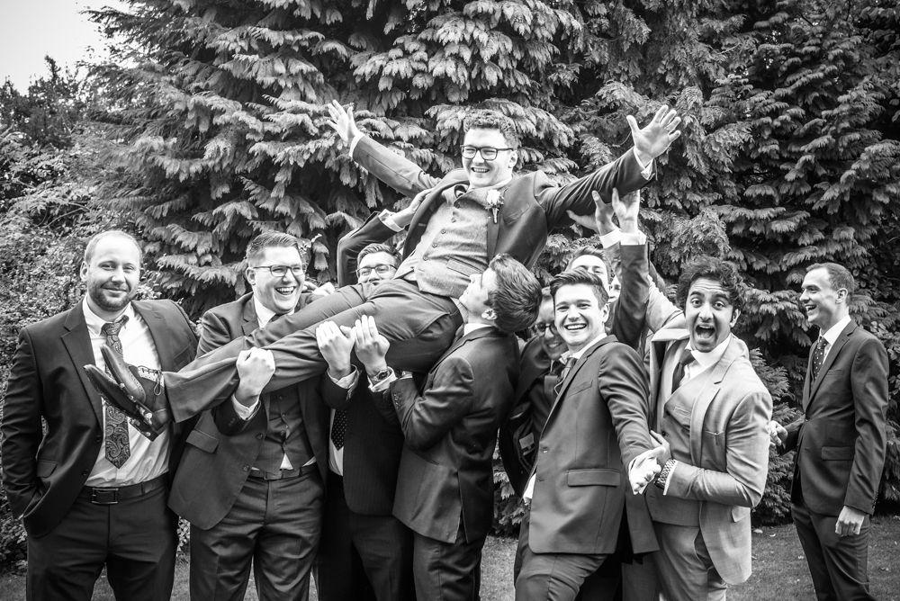 Groomsmen lifting groom photo at Halifax Hall, Sheffield