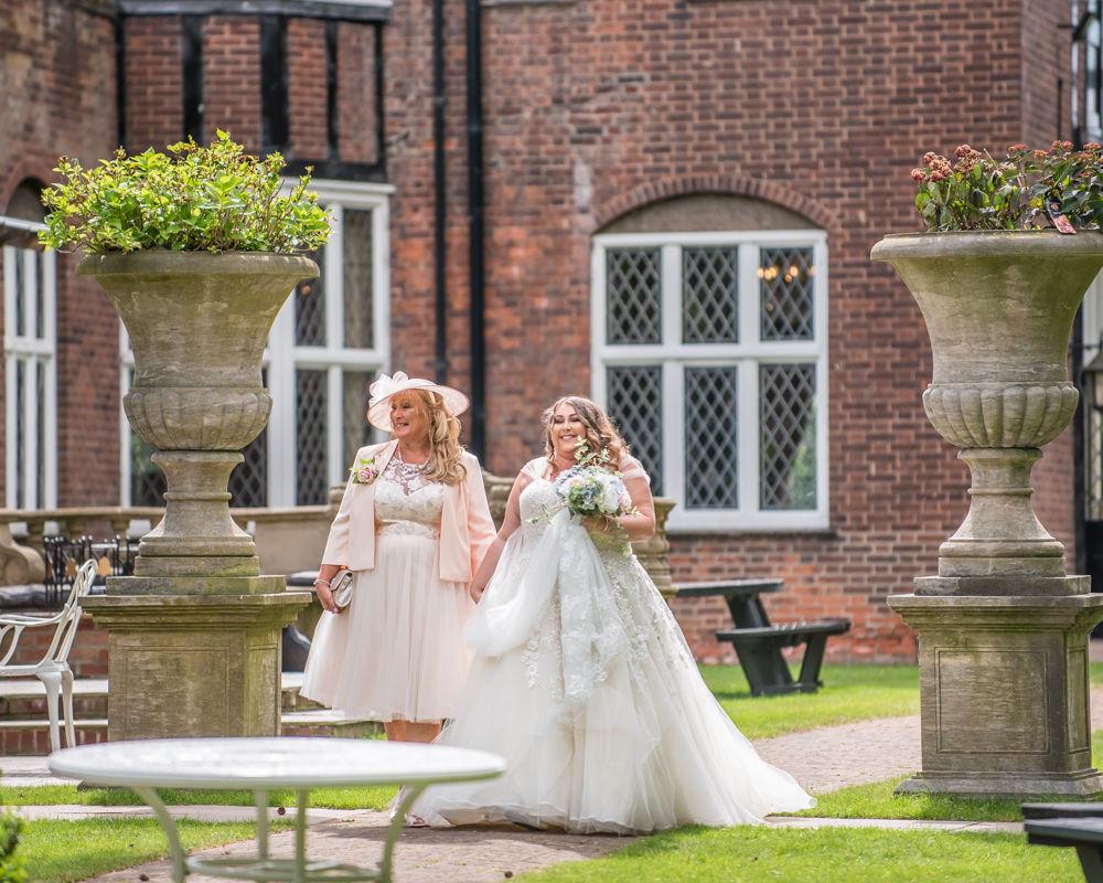 Bride and Mum walking up aisle, Ye Olde Bell wedding, Retford