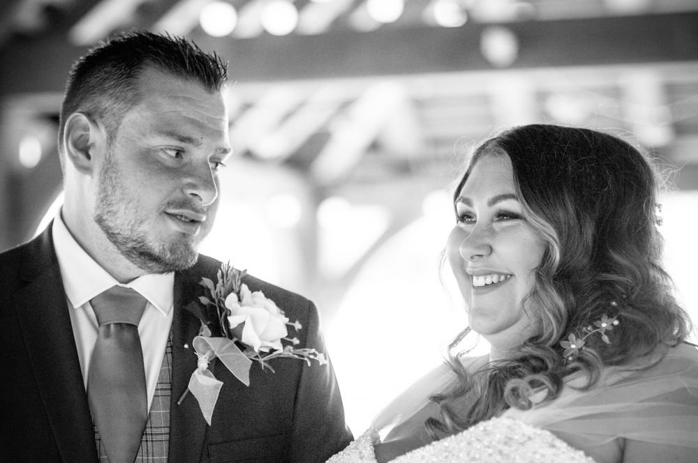 Bride and groom laughing in ceremony, Ye Olde Bell wedding, Retford