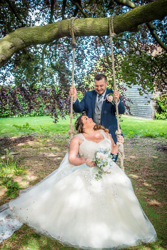 Bride and groom on swing, Ye Olde Bell wedding, Retford