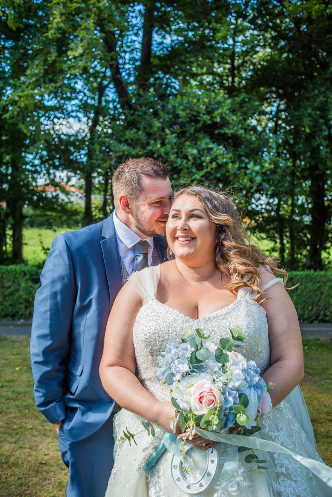 Ben whispering in Alex's ear, Ye Olde Bell wedding, Retford