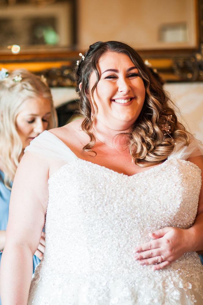 Alex getting her dress on, Yorkshire weddings