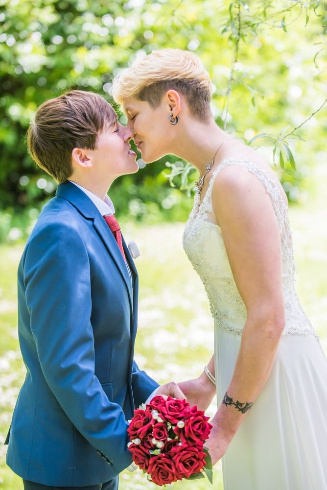 Shirley and Kate kiss, Carlisle Register office, Lake District wedding photography