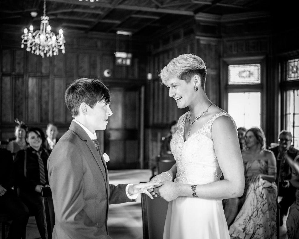 Ring exchange, Carlisle Register office, Lake District wedding photography