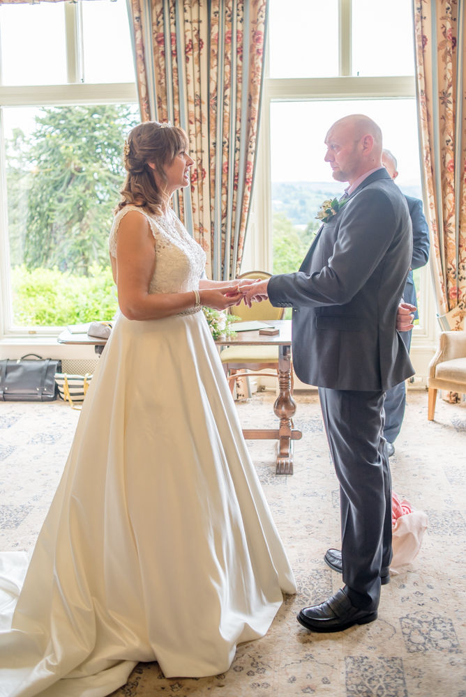 Looking at each other during ring exchange, Merewood Country Hotel Hotel weddings, Lake District