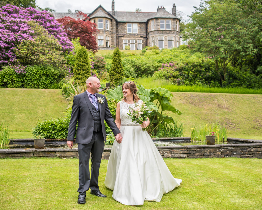 Walking in the grounds with views of the hotel, Merewood Country Hotel Hotel weddings, Lake District
