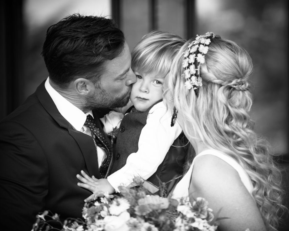 Kissing Callan on cheeks, Overwater Hall wedding, Lake District