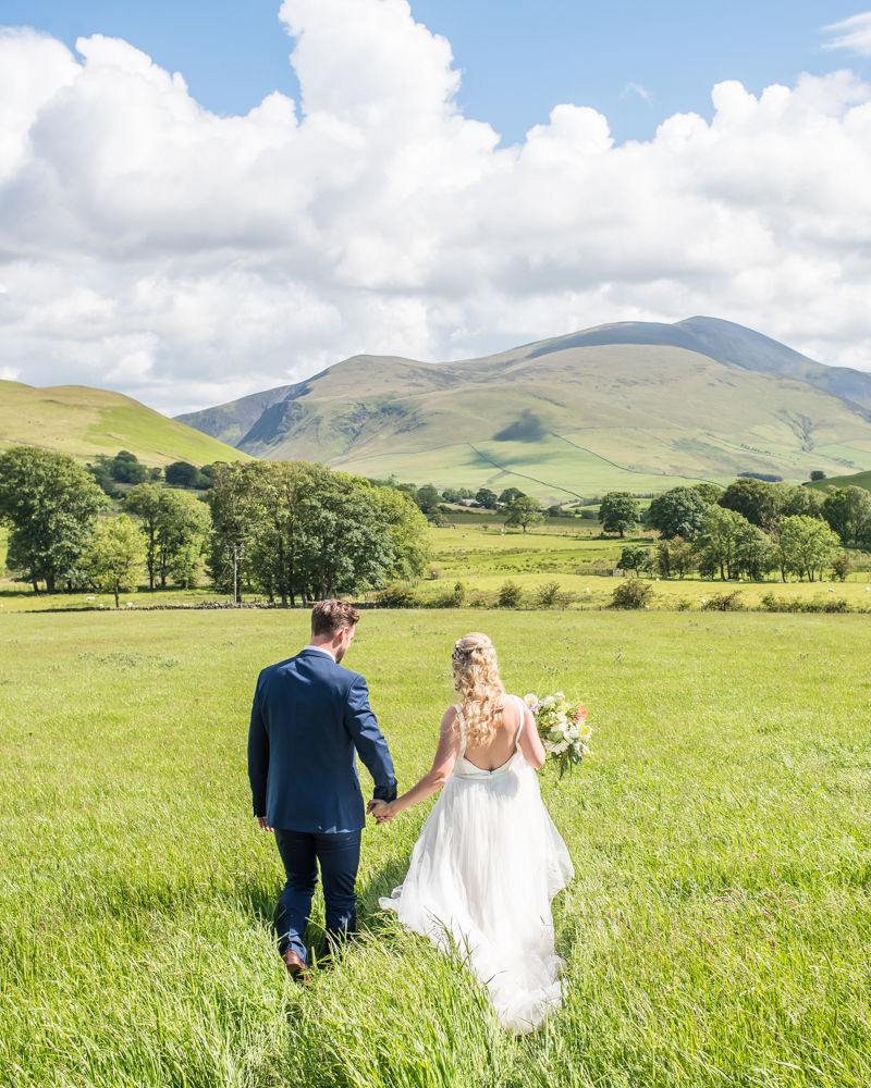 Walking through fields, Overwater Hall wedding, Lake District
