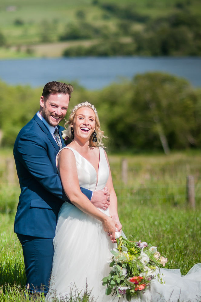 Laughing together, Overwater Hall wedding, Lake District