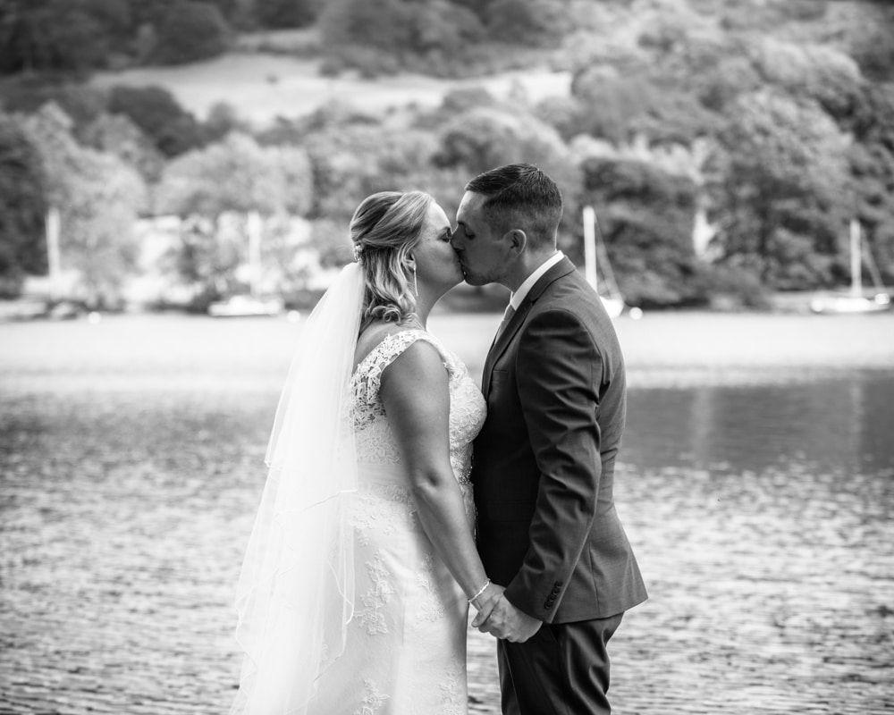 Bride and groom kissing, Lake District weddings