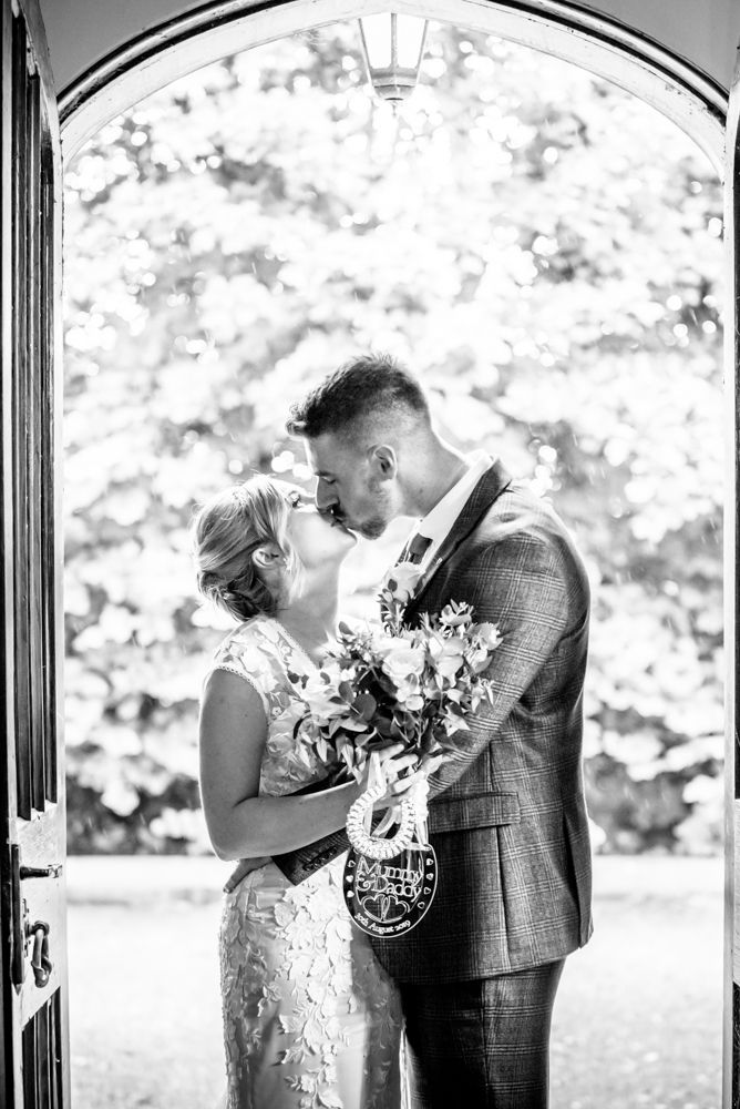 Kisses in doorway,  wedding photographers Carlisle register office elopement wedding Lake District