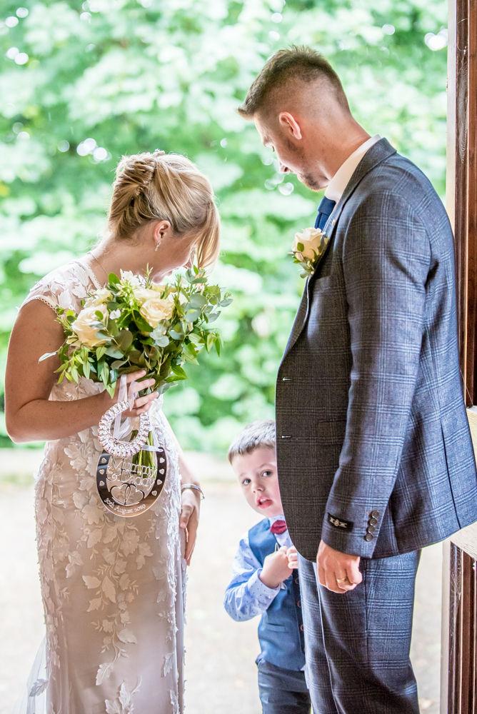 Milo hiding,  wedding photographers Carlisle register office elopement wedding Lake District