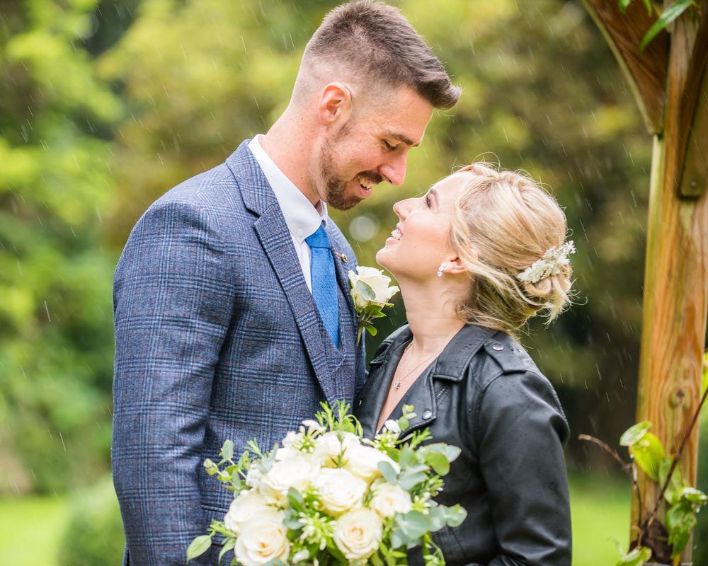 Loving looks in the rain,  wedding photographers Carlisle register office elopement wedding Lake District