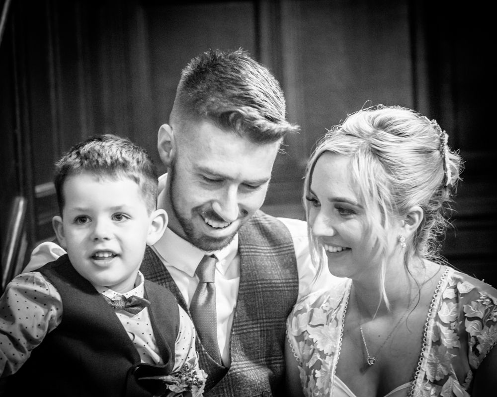 Posing with son Milo,  wedding photographers Carlisle register office elopement wedding Lake District