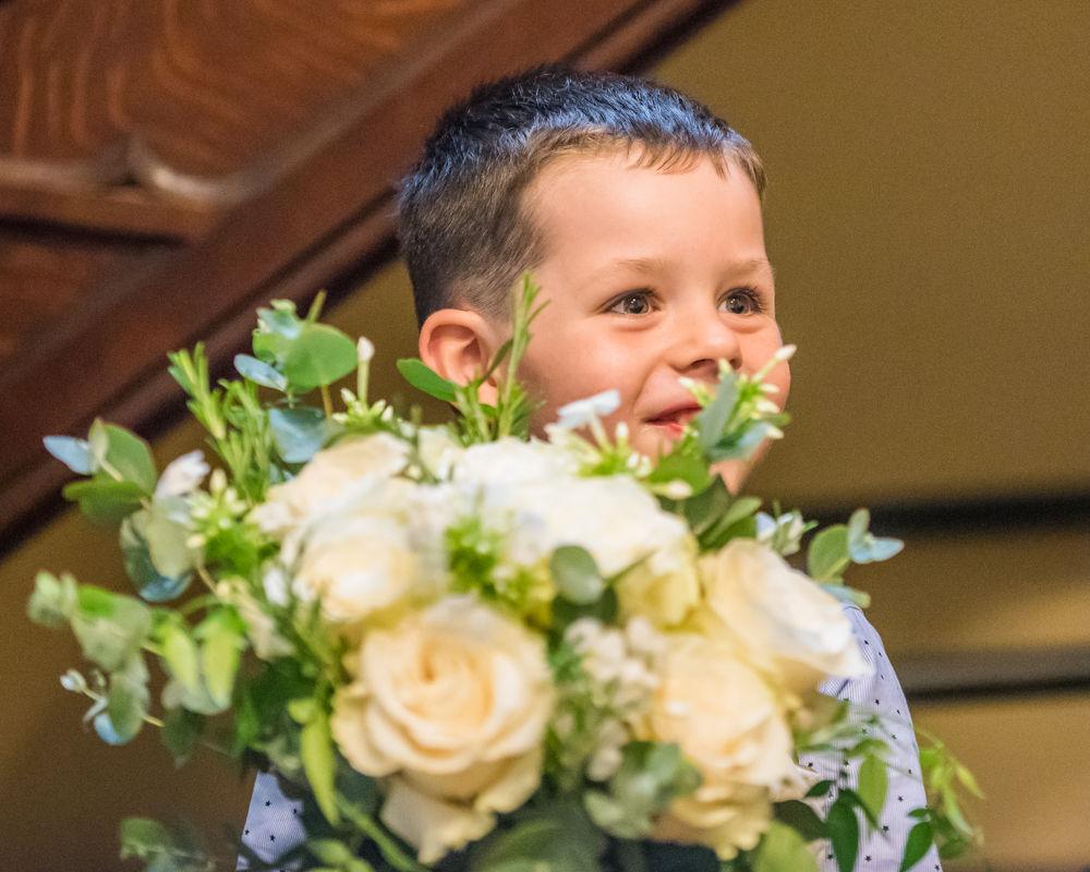 Milo and the wedding bouquet,  wedding photographers Carlisle register office elopement wedding Lake District