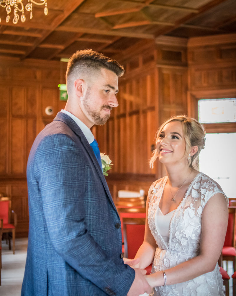 Bride and groom during ceremony,  wedding photographers Carlisle register office elopement wedding Lake District