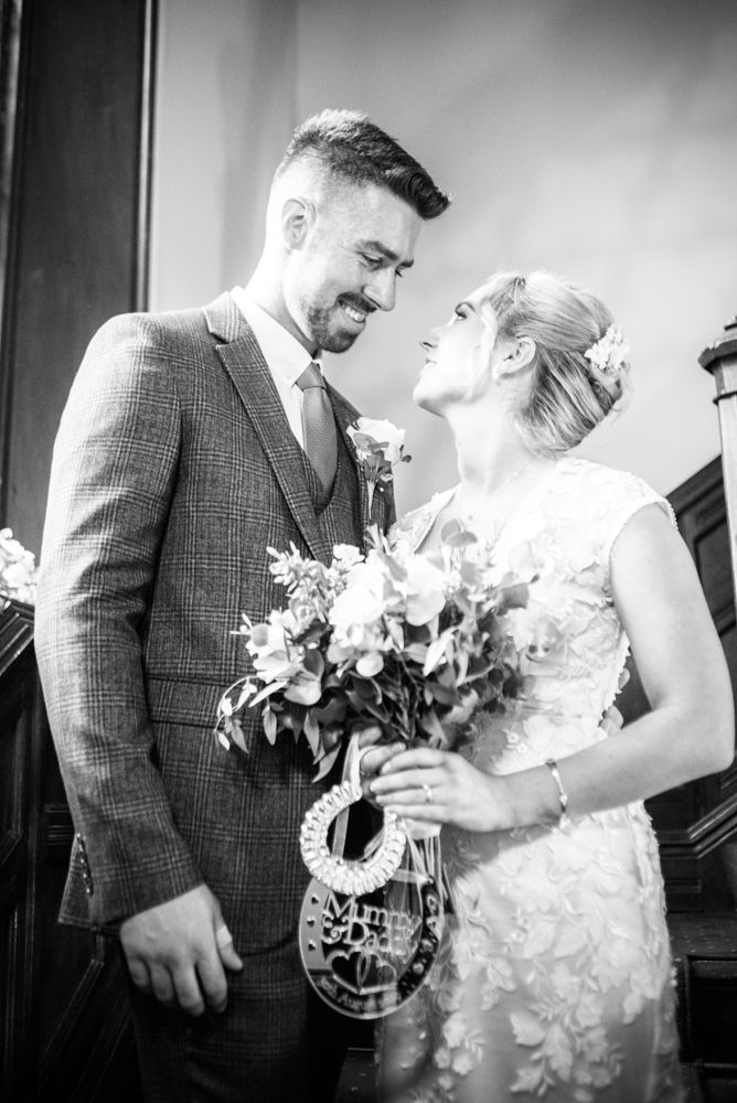 Posing on the staircase,  wedding photographers Carlisle register office elopement wedding Lake District