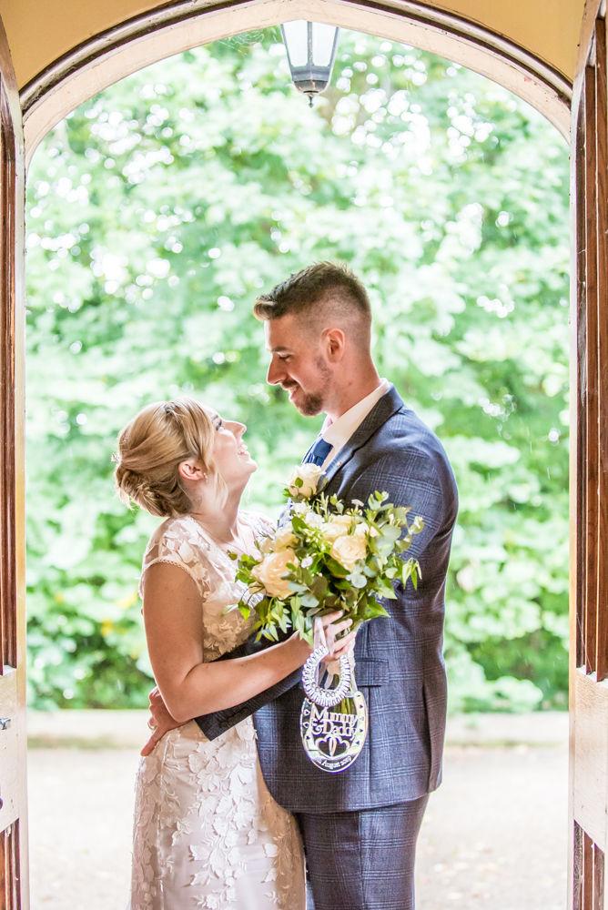 Bride and groom in doorway,  wedding photographers Carlisle register office elopement wedding Lake District
