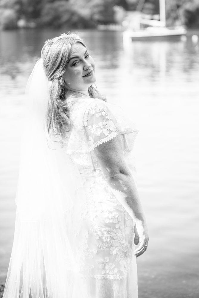 Bride looking over her shoulder, Derwentwater Rock the Dress, Lake District wedding photographer