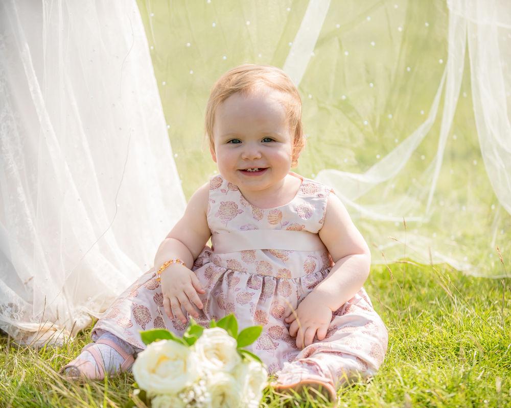 Baby hiding under wedding veil, Derwentwater Rock the Dress, Lake District wedding photographer