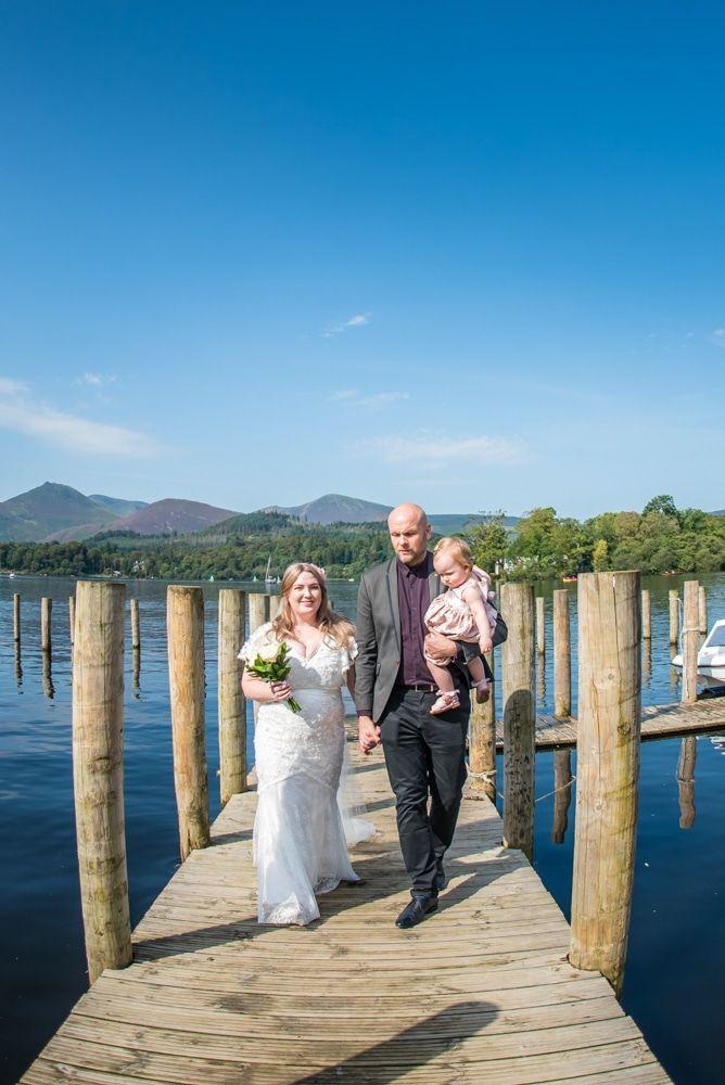 Walking down the jetty, Derwentwater Rock the Dress, Lake District wedding photographer