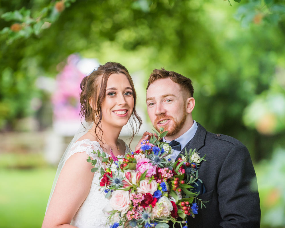 Sheltering under a tree from the rain! Sheffield wedding photographers, Ringwood Hall Hotel