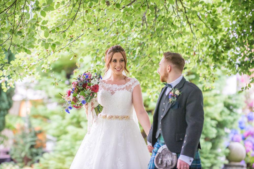 Walking through Ringwood Hall grounds. Sheffield wedding photographers, Ringwood Hall Hotel
