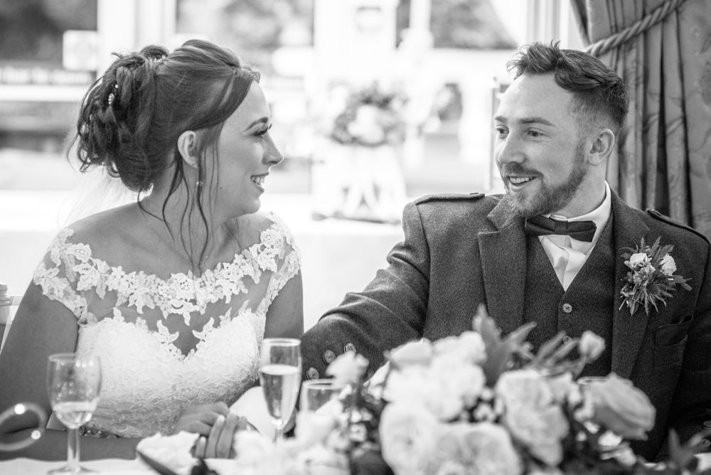 The look of love during speeches, Sheffield wedding photographers, Ringwood Hall Hotel