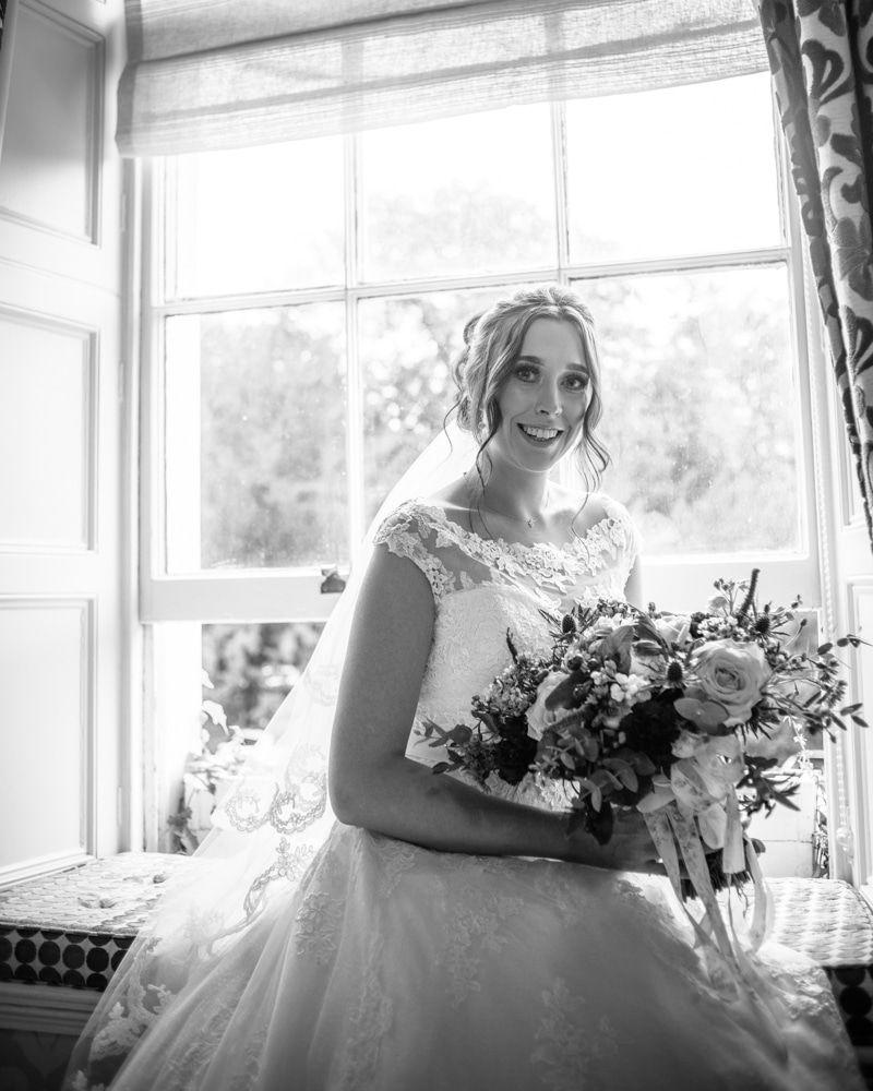 Bride posing in window seat before wedding, Sheffield wedding photographers, Ringwood Hall Hotel
