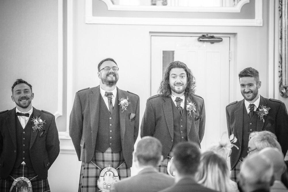 Groomsmen waiting nervously in ceremony, Sheffield wedding photographers, Ringwood Hall Hotel